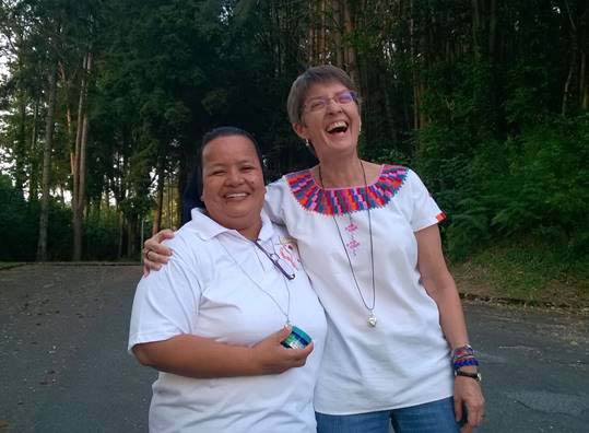 S. Dani laughs with her friend in Guatemala.