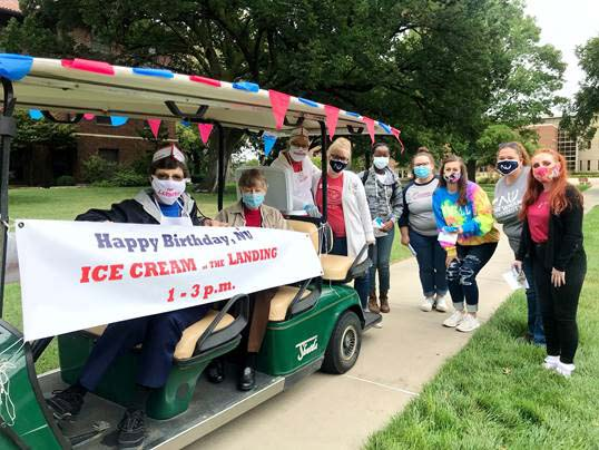 Sisters deliver ice cream to Newman University students in a golf cart.